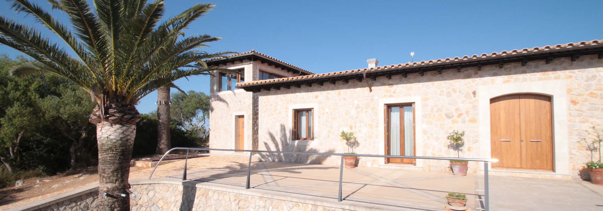 Natural stone cladding country house on a hill with panoramic sea views close to Manacor